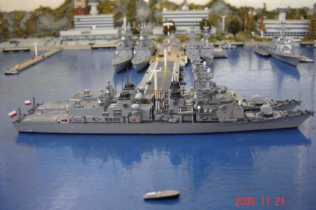 modified Murasame class destroyers in port.